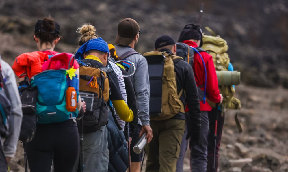 A group of active tourists climbing to the top of the Kilimanjaro