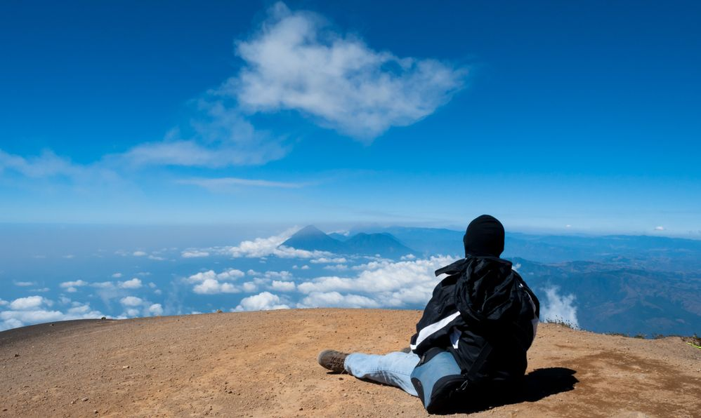 Looking at the surrounding volcanoes from the summit of Acatenango volcano , Guatemala