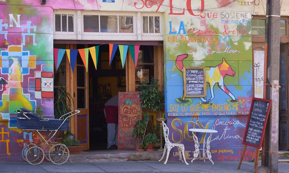 Colourful graffiti decorating a shop cafe in the world heritage city of Valparaiso in Chile