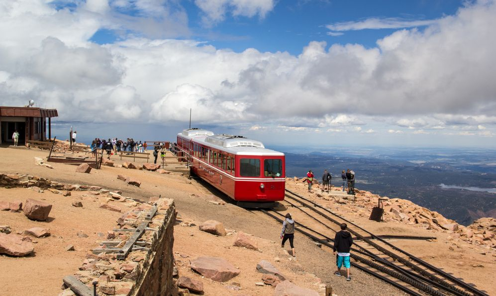 ourists enjoy the view after arriving to Pikes Peak on the cog railway