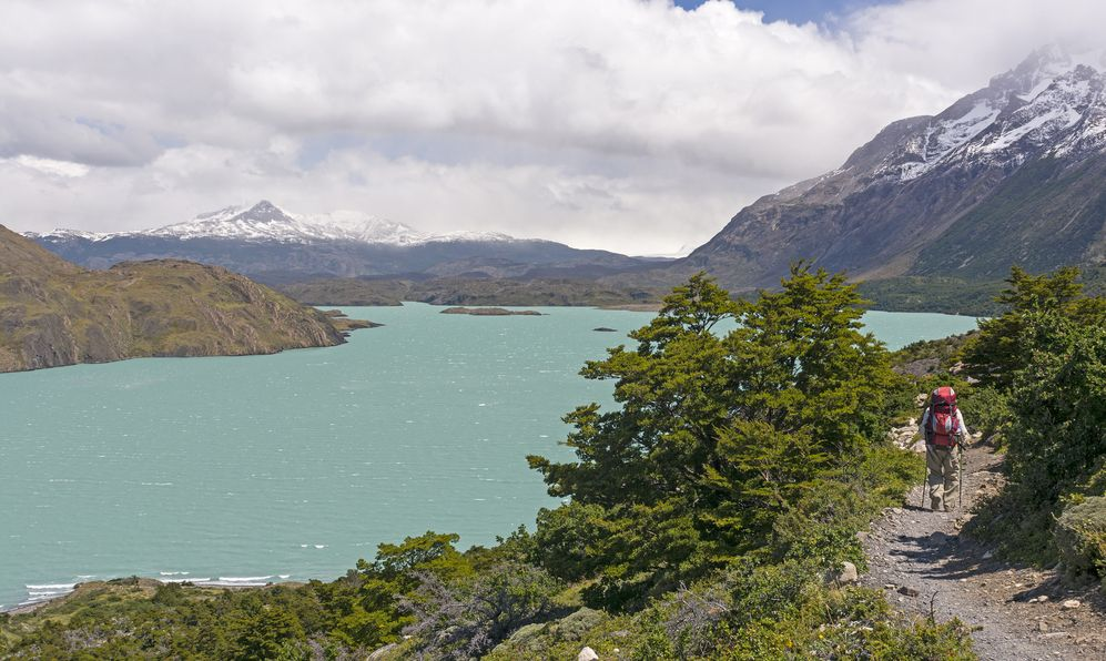 Backpacker on the W- trek trail along Lake Nordernskjold in Torres del Paine National Park in Patagonian Chile