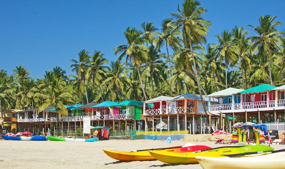 Palolem beach Southern Goa, India colorful sea front bungalows landscape