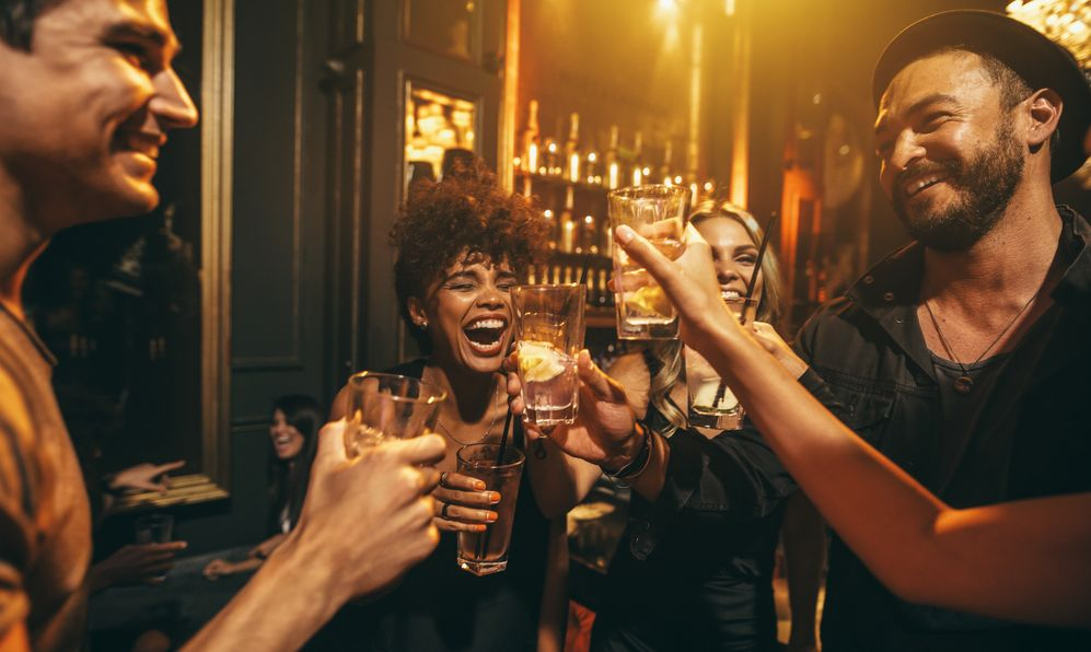 Shot of young men and women enjoying a party.
