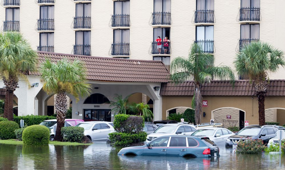 Cars submerged near hotel from hurricane Harvey