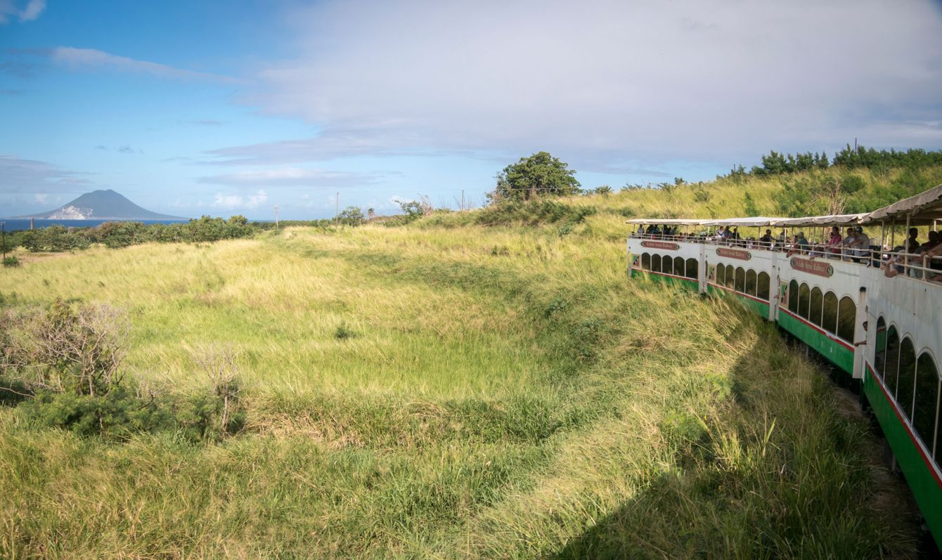 The scenic railway on the island of St Kitts with the island of Nevis in the distance