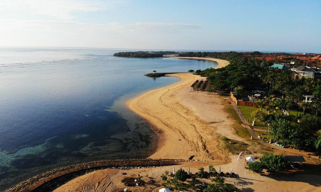 Beautiful drone view of white sand beach, Nusa Dua, Bali.