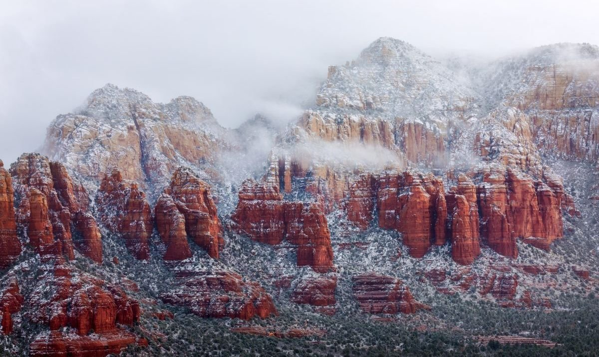 Red rocks covered with snow and fog after a winter storm in Sedona, Arizona.