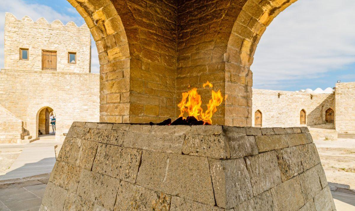 Ancient stone temple of Atashgah with burning flame inside, Zoroastrian place of fire worship, Baku, Azerbaijan