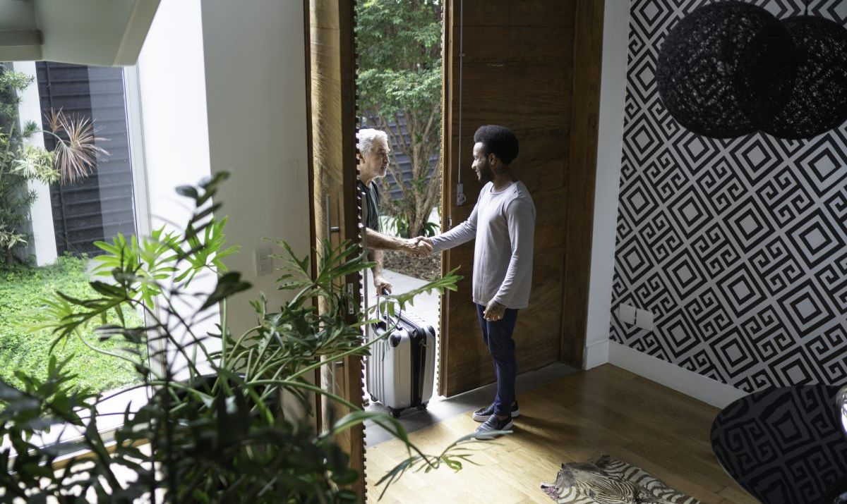 Host and guest meeting at front door