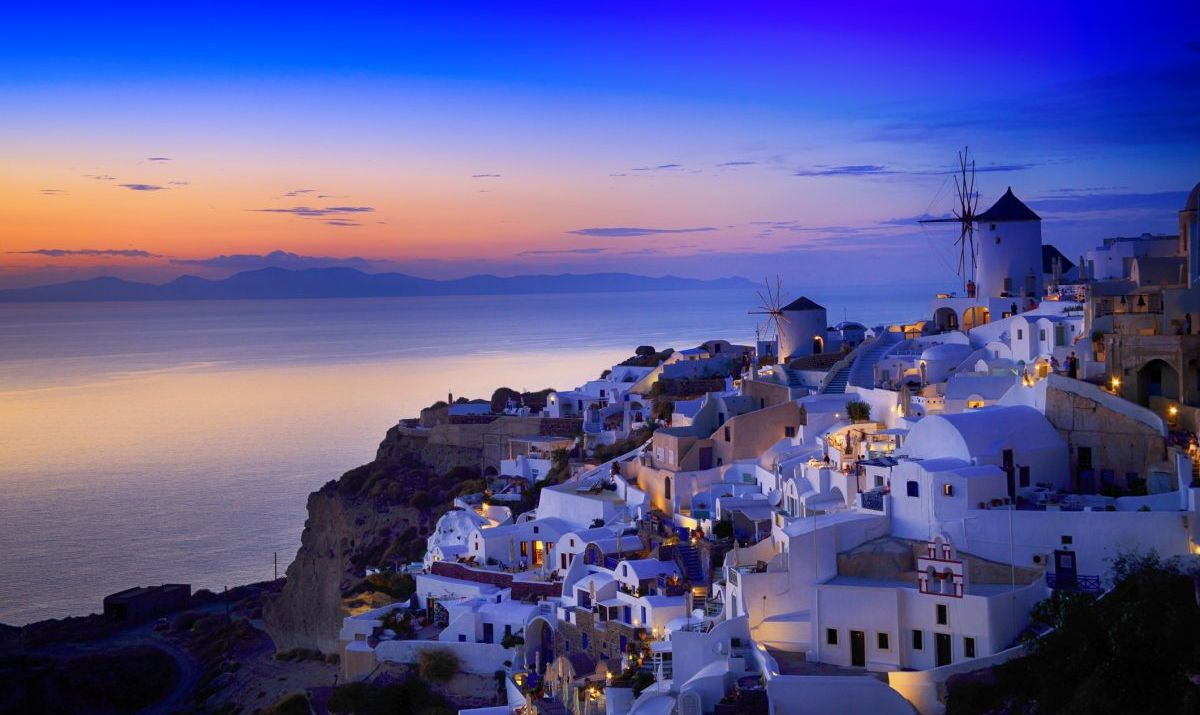 Night view of Santorini island, Greece. Buildings and sea.