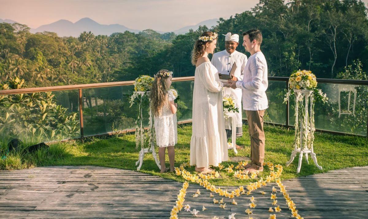 Happy newlyweds couple in marriage, wedding ceremony in Ubud