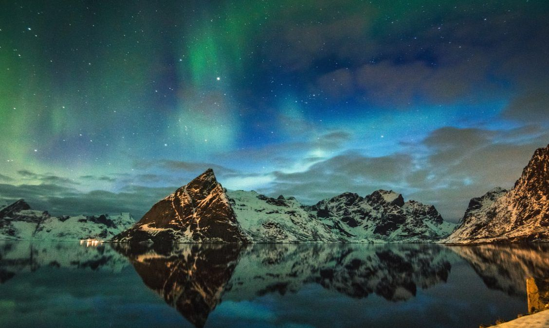 view of reine at lofoten with the aurora borealis