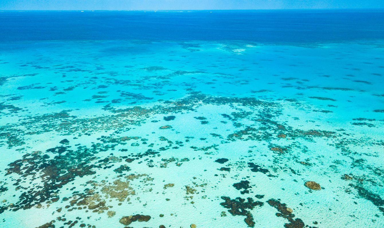Aerial view made with drone of Canareef Resort Maldives, Addu City, Herathera island, Addu atoll (former Seenu Atoll), Maldives. Luxury travel holidays background.