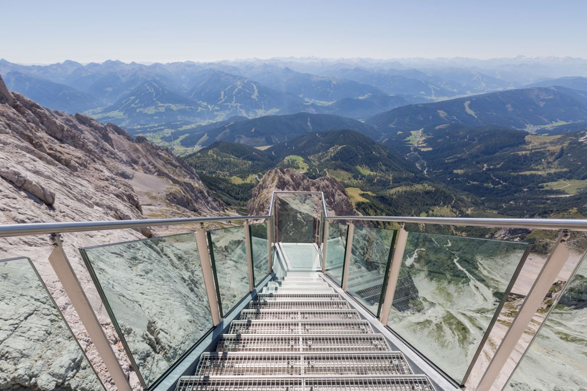 Steps to a hanging lookout of alpine landscape seen from Dachstein glacier, Austria