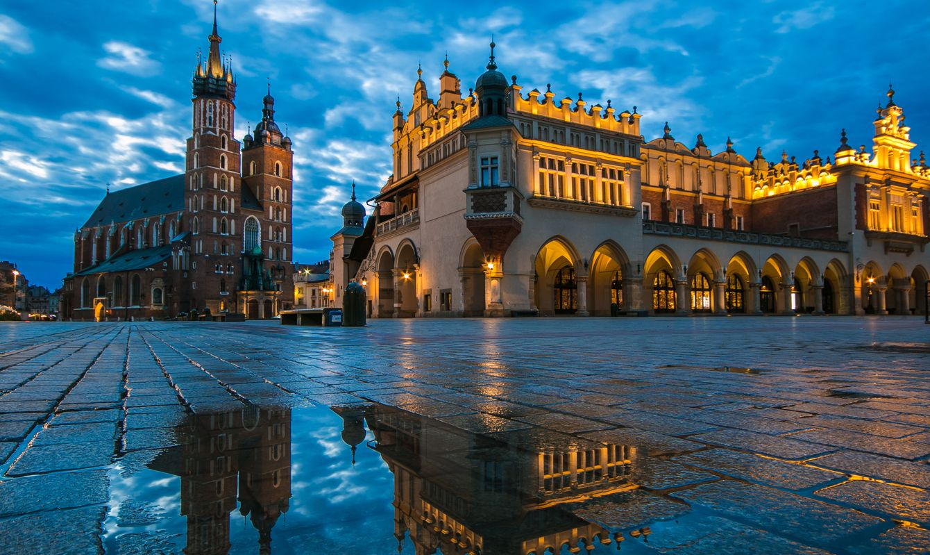 Panoramic view of old Market Square at beautiful sunrise in Krakow on fainy day, Poland, Europe