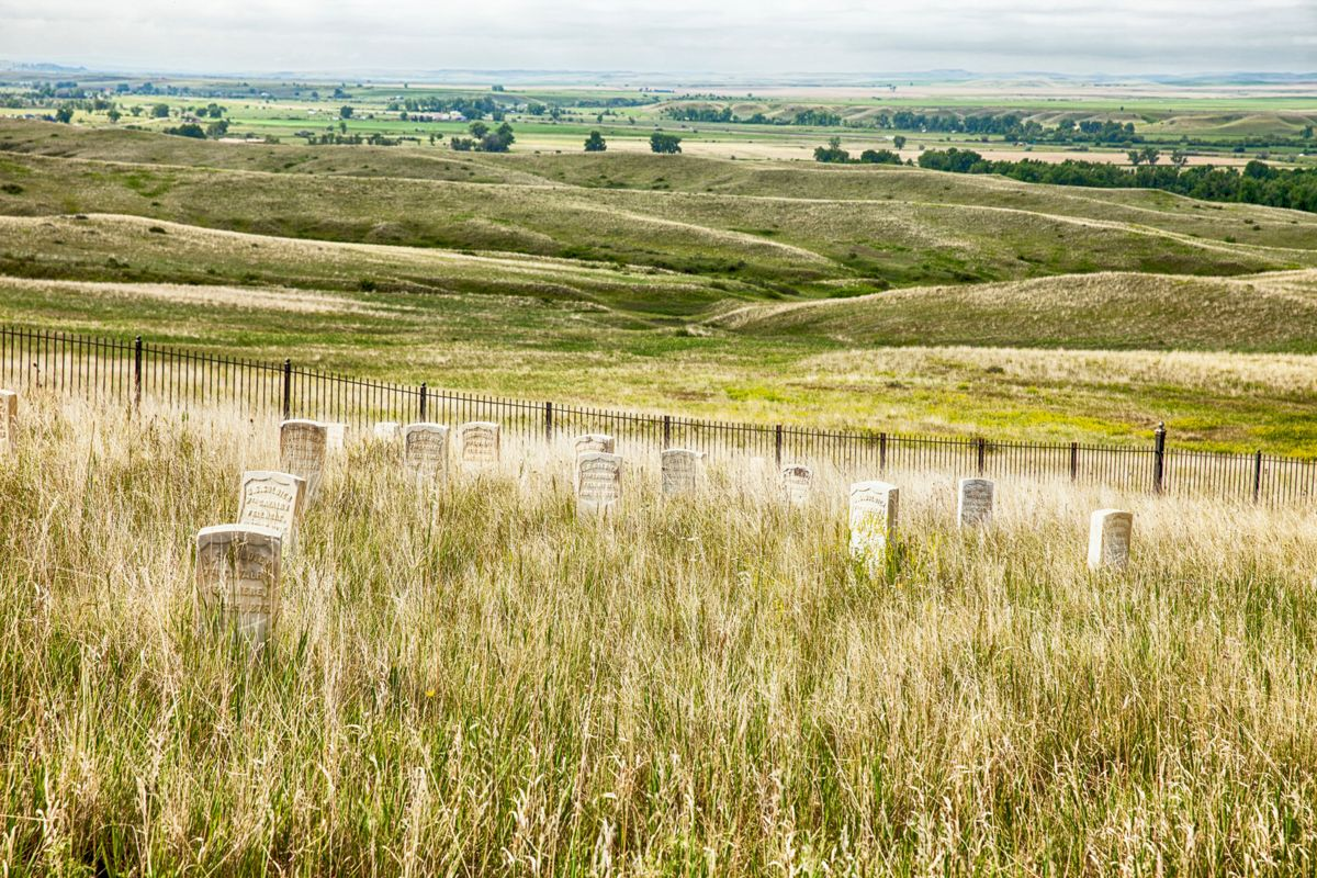 Gravestones in the cemetery look out over the battlefield at Little Bighorn in Montana where General George Custer's 7th Cavalry and the Lakota Sioux fought a fierce battle in 1876.