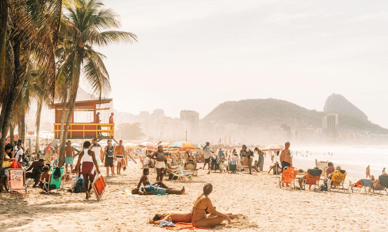 people relaxing and sunbathing at famous Copacabana beach, Rio de Janeiro, Brazil