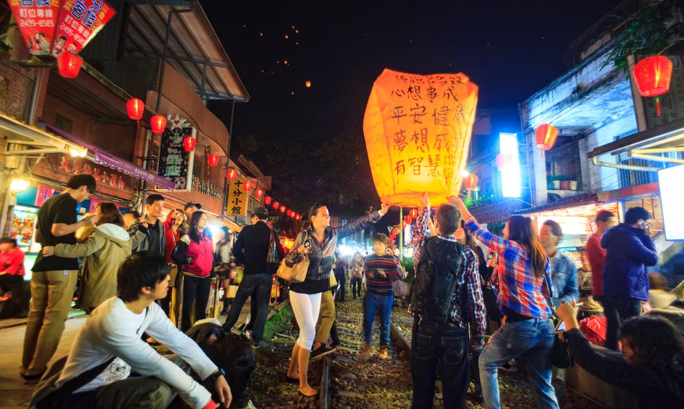 ourists Launching Sky Lantern Along Railway Next to Shifen Train Station of Pingxi Line