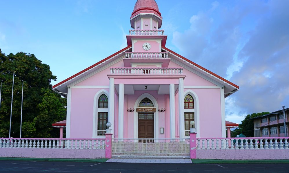iew of the Protestant Temple Getesemane de Mahina, a pink church located near Papeete, Tahiti,