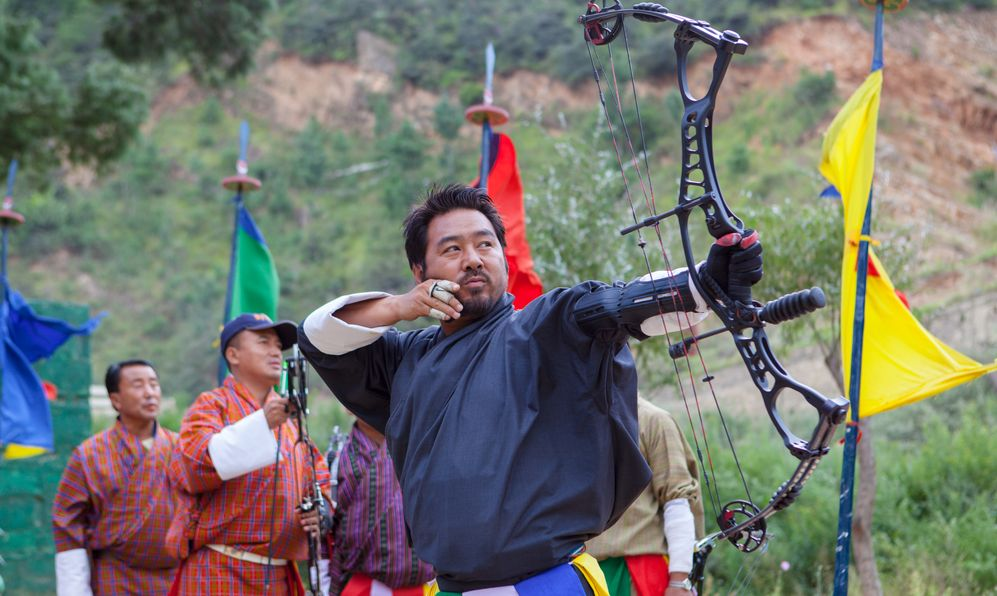 Bhutanese men compete in a game of archery