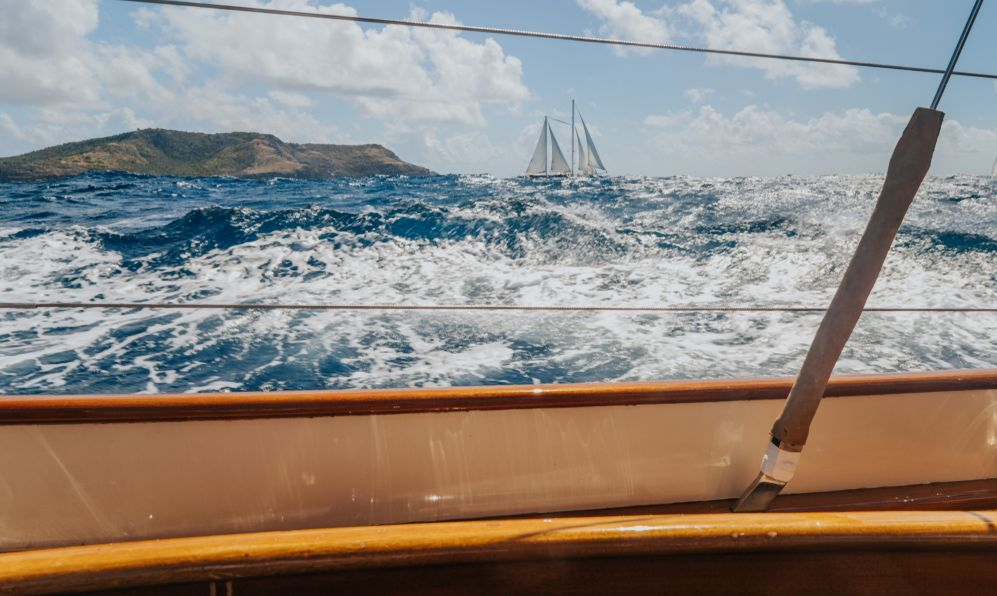 Sailboat regatta in Antigua, on the Caribbean Sea, Antigua classic week, white waves on the sea from the yacht