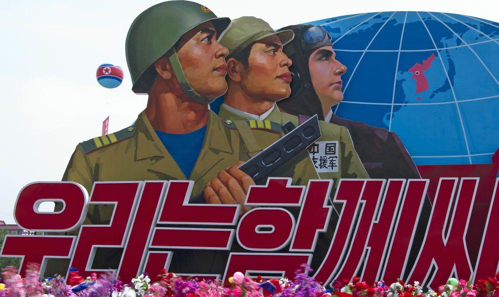 North Korean soldiers placard at the military parade in Pyongyang. Pyongyang, North Korea,