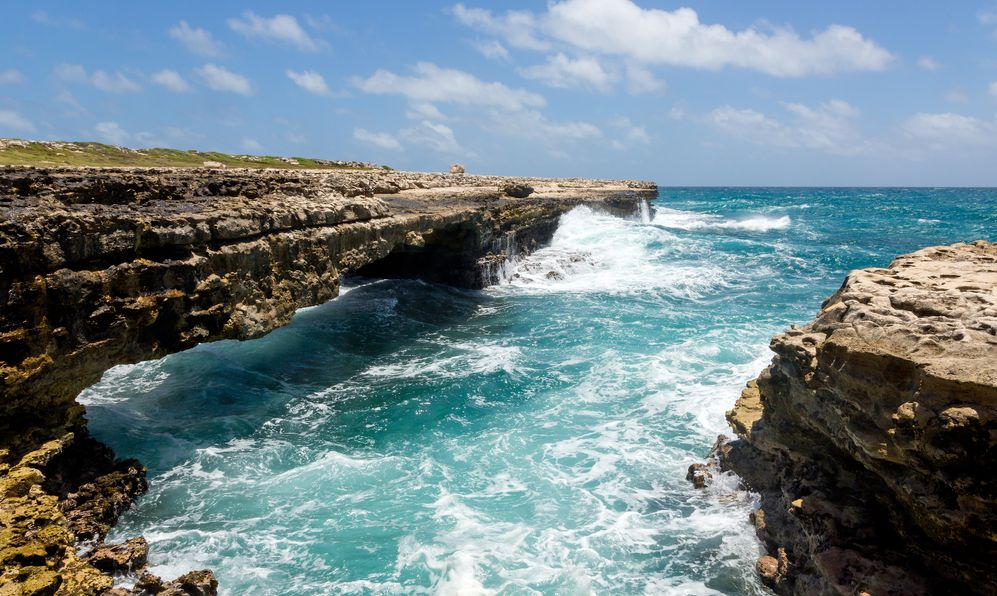 Waves Crashing on Rocks at Devil's Bridge Antigua in Sunshine