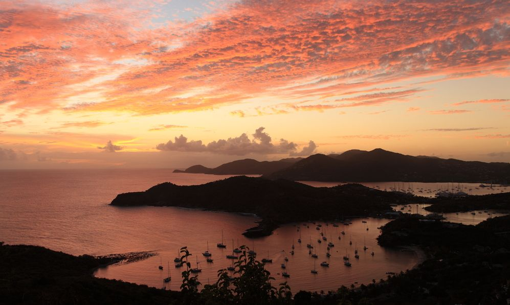 Sunset over famous English harbour, Antgiua in the Caribbean from a hill