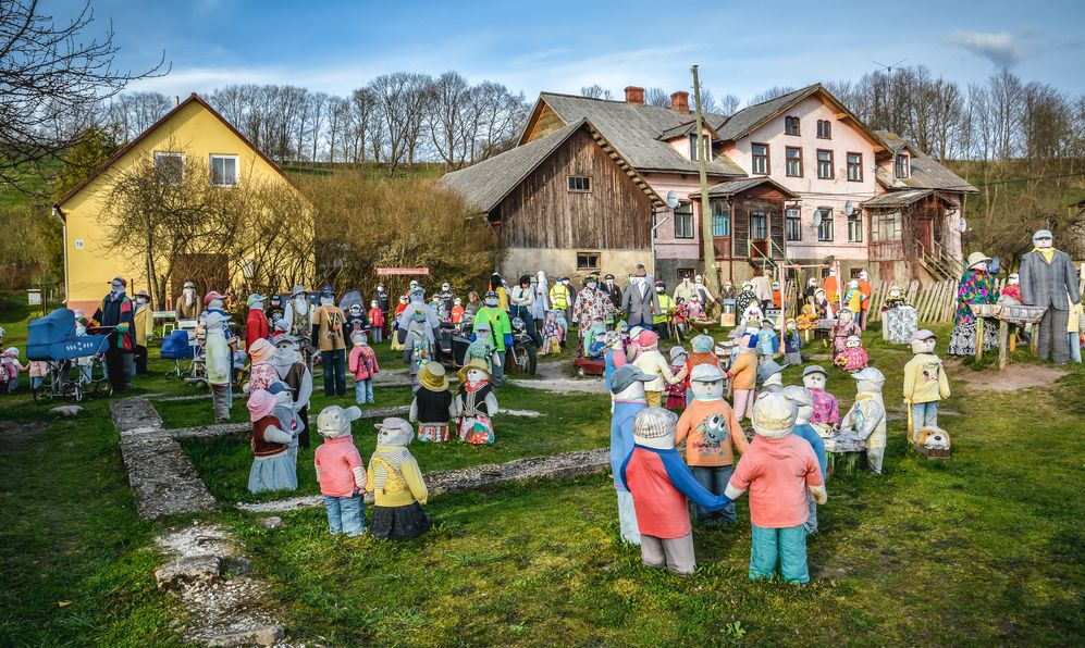 Garden full of puppets dressed up as singers, policemen, sportsmen, families etc. Shot in Sabile, Latvia