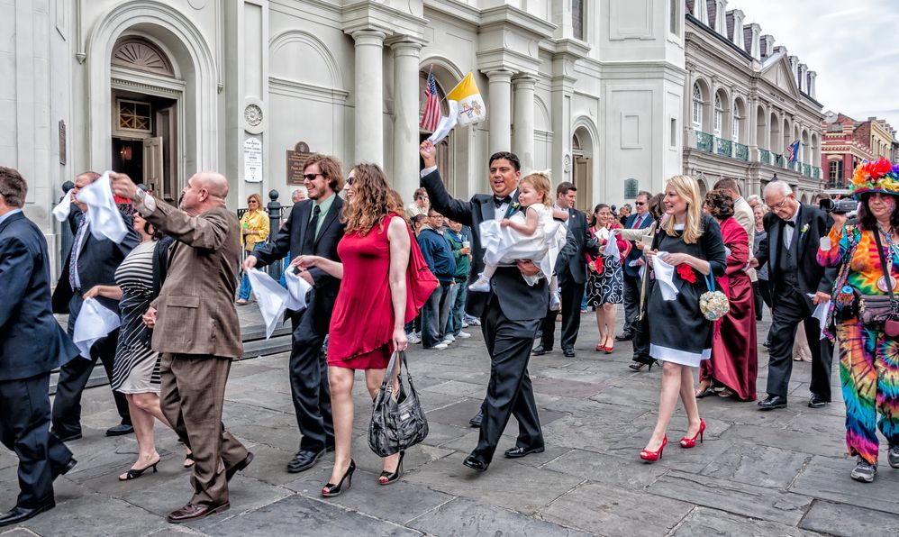 A post-wedding second-line parades in front of St. Louis Cathedral in the French Quarter