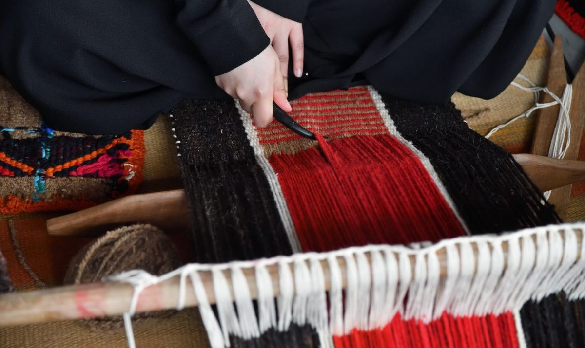 Hands of an arabian weaver