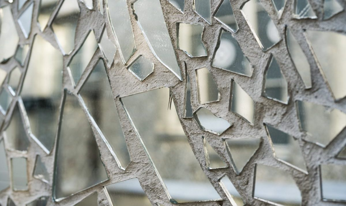 Shards of a mirror glass pattern on a wall.