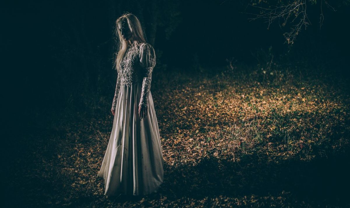 Undead woman in the dark - stock photo
