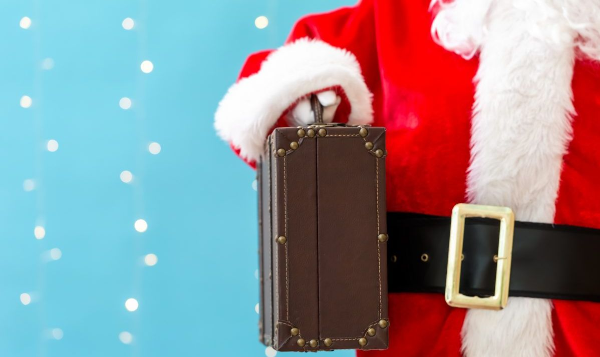 Santa holding a suitcase