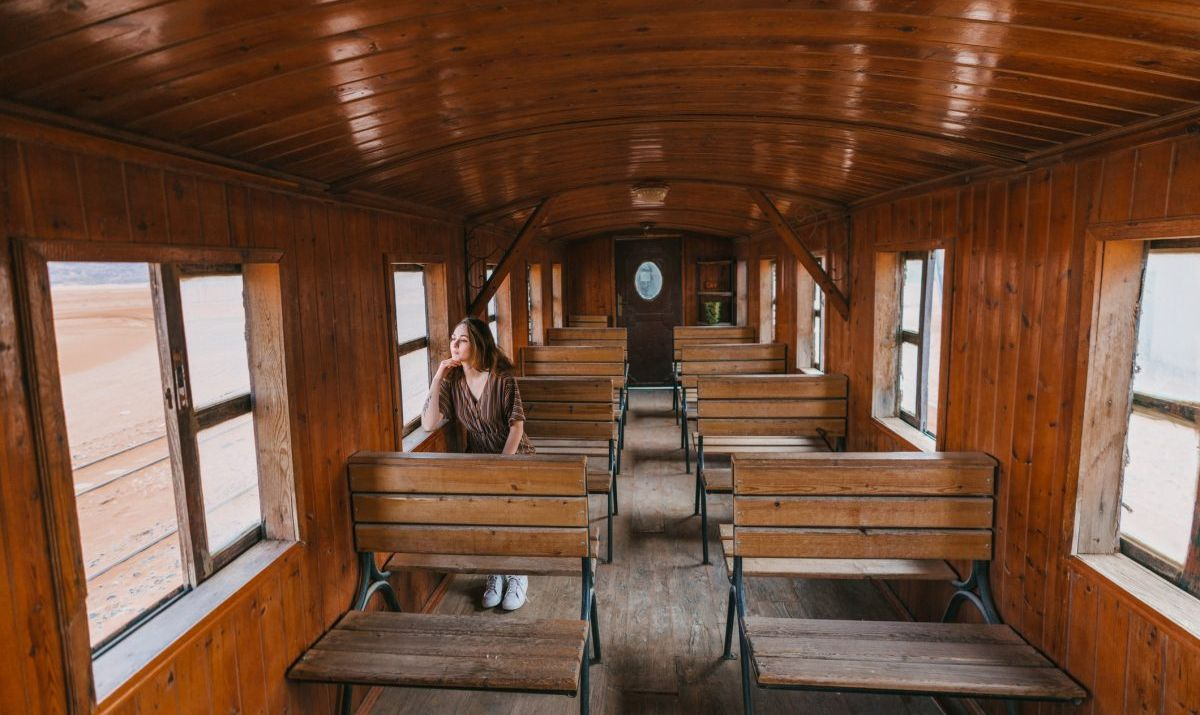 woman sitting in old fashioned train