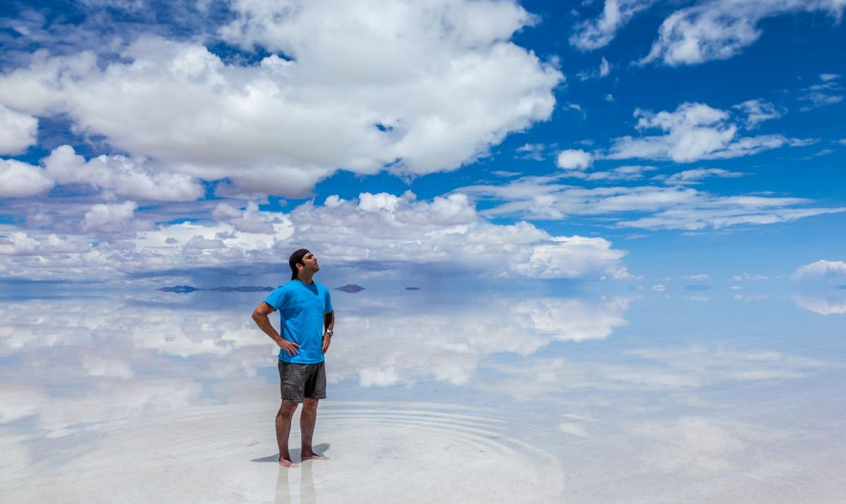 Man standing in the Salar de Uyuni, february, Bolivia