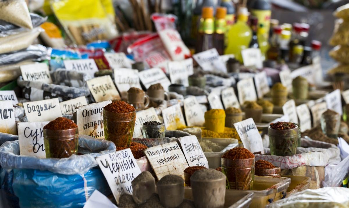 Beautiful vivid oriental market with bags full of various spices - stock photo