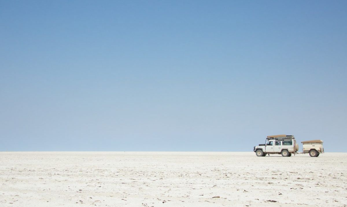 SUV driving in the salt pans of Botswana.