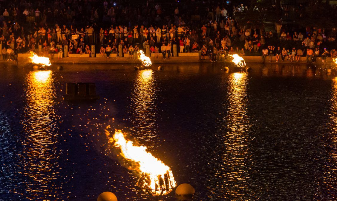 Crowds enjoy the glow of the WaterFire display