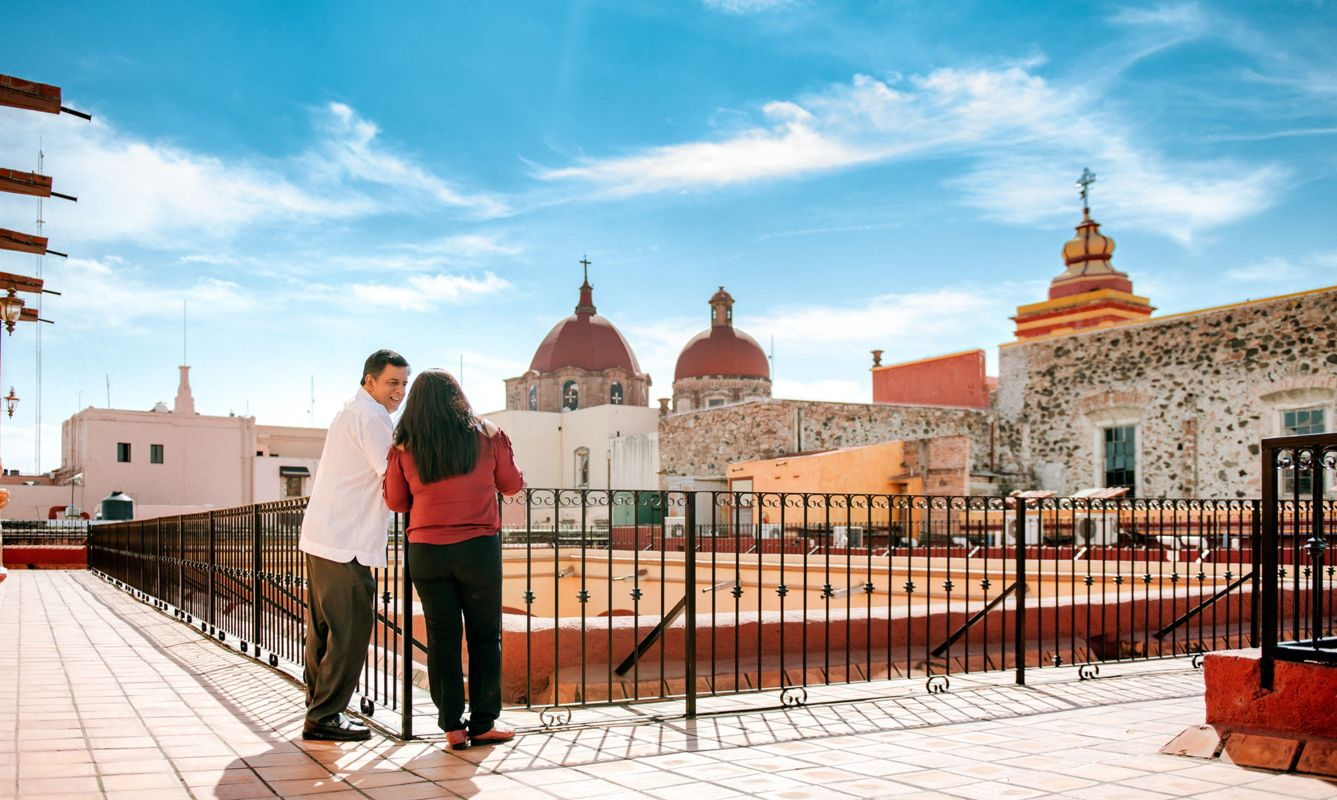 Senior Couple exploring the views from a Mexican Hotel Rooftop