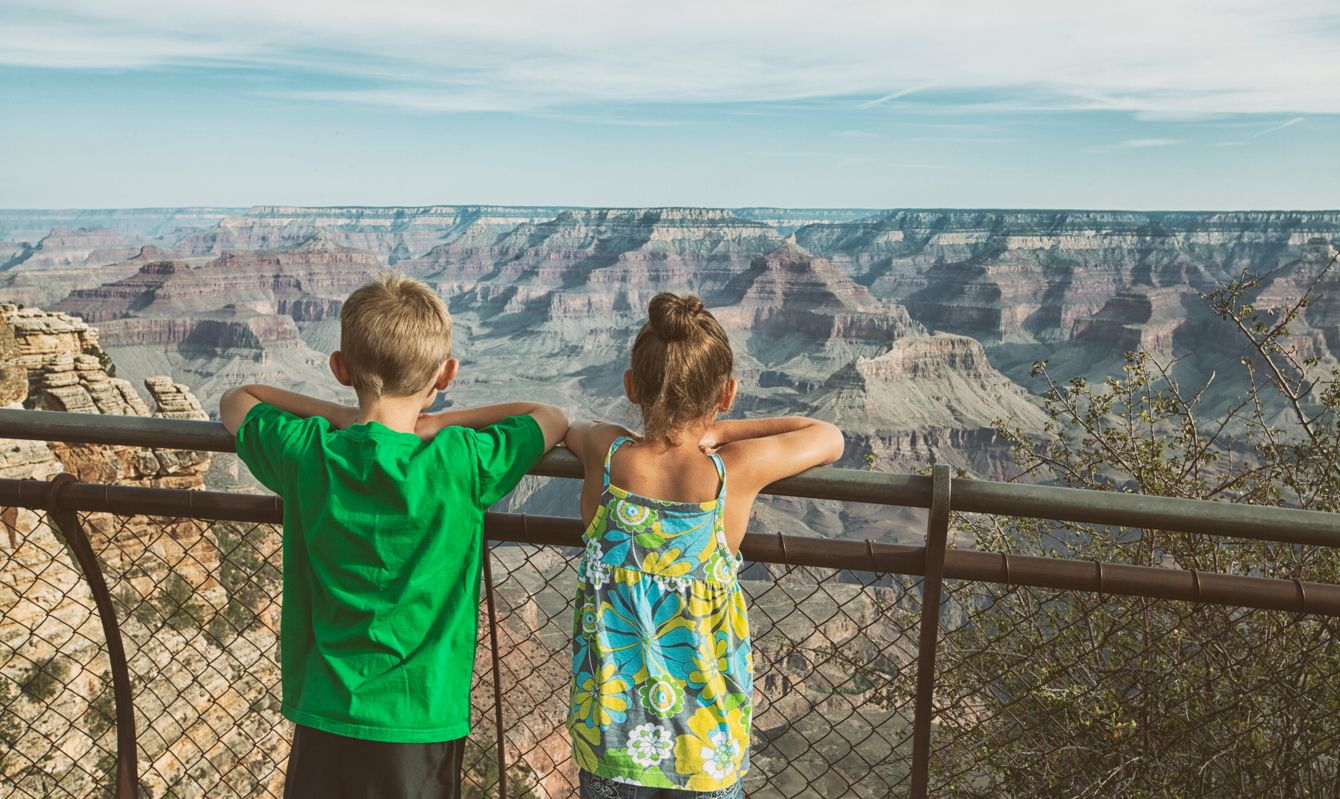 boy and girl enjoying view of Grand Canyon