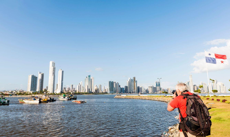 Senior men photographing a Panorama of Panama city.