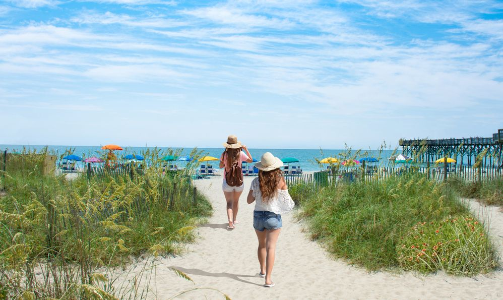 Girls walking on the beach on summer vacation