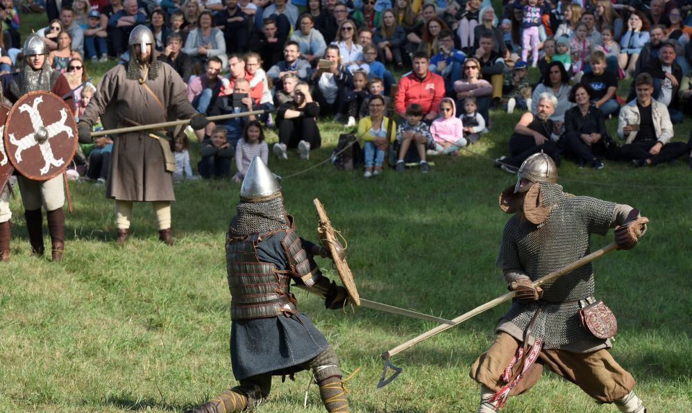 Unidentified people in a Medieval fights at International Festival of Experimental Archeology