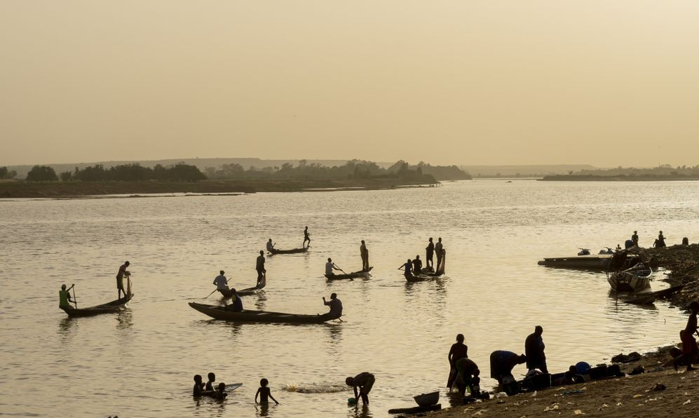 Silhouette of Nigerien fishermen fishing on their boats