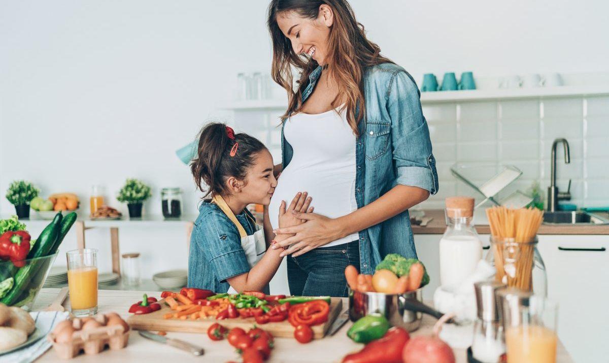 mother daughter meal prep veggies