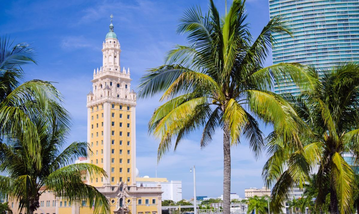 The Freedom Tower looms over downtown Miami, topped with an art deco beacon.
