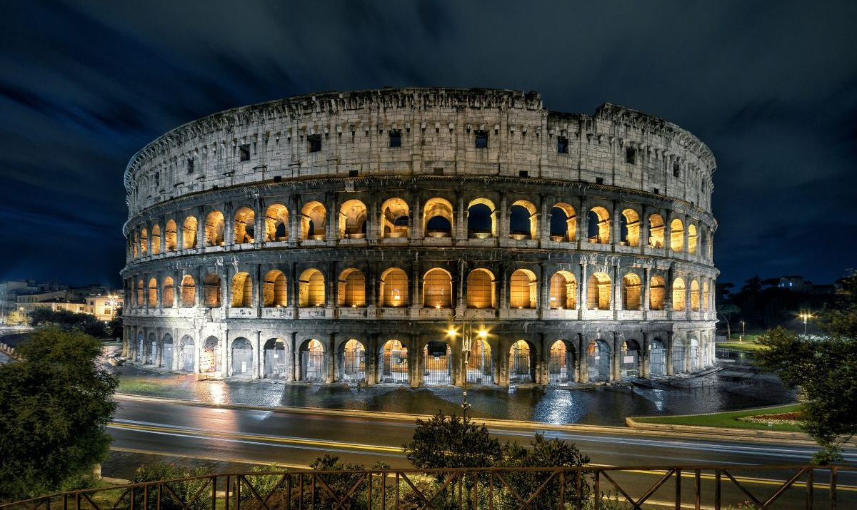 The mighty Colosseum at night.