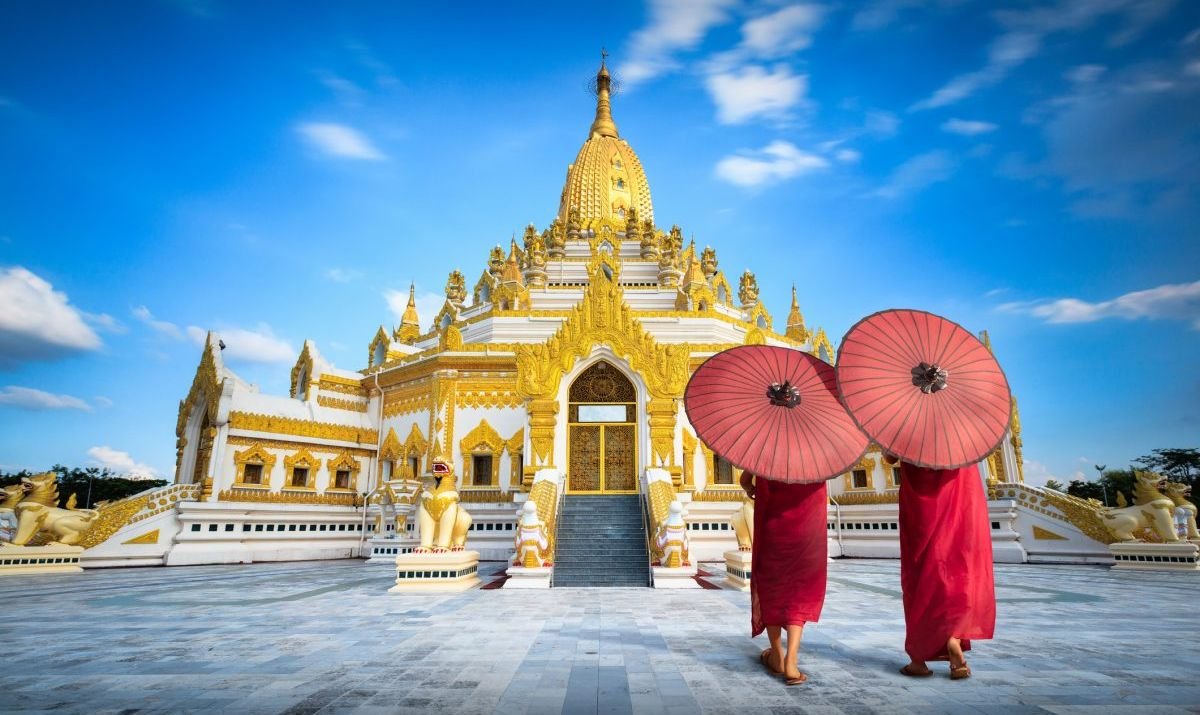 A pair of women standing outside the Swe Taw Myat Buddha Tooth Pagoda