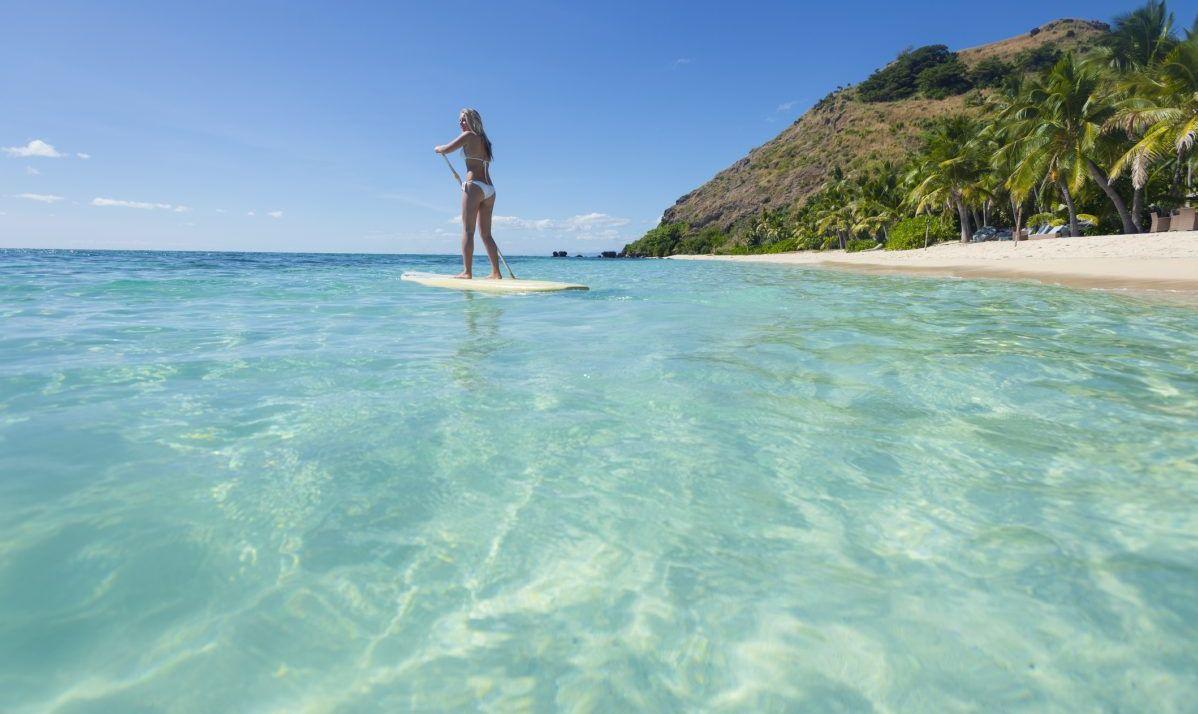 fiji surfing sunbathing